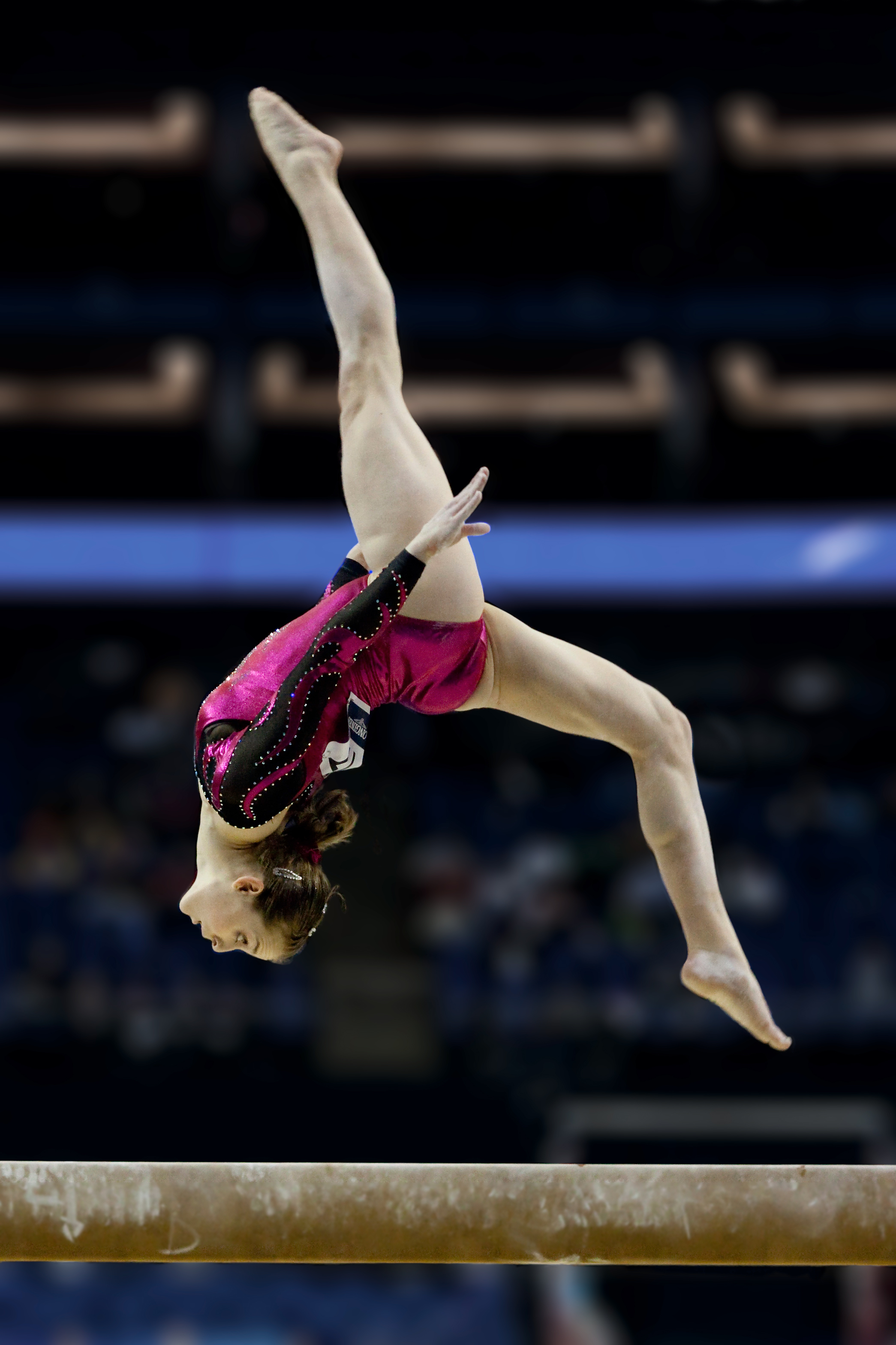 Australian artistic gymnast, Lauren Mitchell, performing a layout step-out on the balance beam during the 41st World Artistic Gymnastics Championships in London, United Kingdom, in 2009.